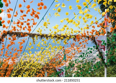 Aerial view of Funchal, Madeira, through the flowers of a decorated staircase near a church
