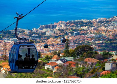 Aerial view of Funchal with traditional cable car above the city, in Madeira island, Portugal