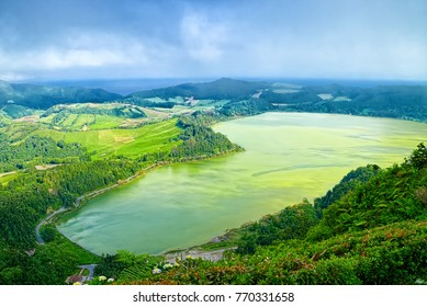Aerial view of Furnas Lagoon (Portuguese: Lagoa das Furnas), located on Azorean island of Sao Miguel in Atlantic Ocean. Slightly fogged skyline.