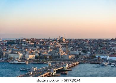 Aerial view of Galata bridge of Golden Horn bay and Eminonu station. Istanbul, Turkey