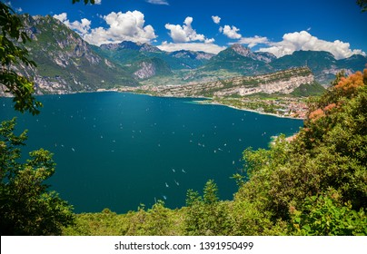 aerial view of the Garda lake near Torbole and Riva del Garda with a lot of windsurfers, Italy
