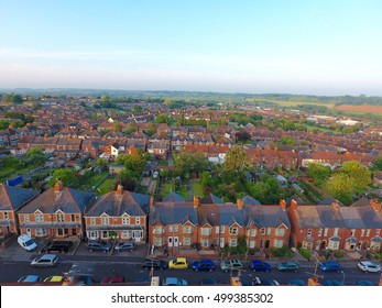 Aerial view of garden and roof tops of British housing development