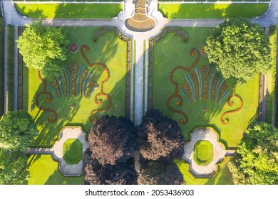 Aerial view Gardens of czech historical town Cesky Krumlov.  UNESCO World Heritage Site in beautiful golden morning light at sunrise in fall. - Shutterstock ID 2053436903