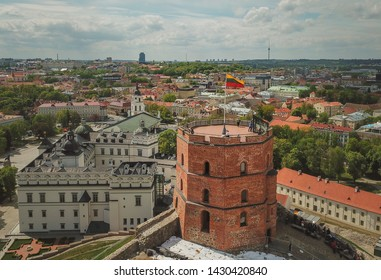 Aerial view of Gediminas castle  in capital Vilnius of Lithuania with Lithuanian flag on the tower and skyline of city center in the background.