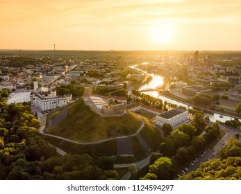 Aerial view of Gediminas' Tower, the remaining part of the Upper Castle in Vilnius. Sunset landscape of UNESCO-inscribed Old Town of Vilnius, the heartland of the city, Lithuania.