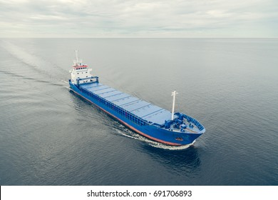 Aerial view of general cargo ship in open sea
