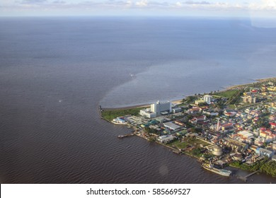 Aerial view to Georgetown city the capital of Guyana. The confluence of the Demerara river into the Atlantic ocean