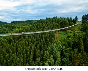 aerial view Germany's longest rope suspension bridge 300 feet above a canyon floor Geierley. It is between the towns of Morsdorf and Sosberg