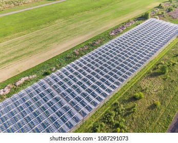 Aerial view of glass greenhouses in the fields of Poland