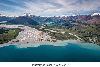 Aerial view of Glenorchy, Lake Wakatipu and Mount Aspiring at the base of Dart River and Rees River mouth near Queenstown, South Island, New Zealand. Mount Alfred, Greenstone and Routeburn tracks.