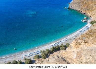 Aerial view of Glyka Nera beach (Sweet Water or Fresh Water). View of the remote and famous Sweet Water Beach in south Crete, with its unique tavern on the rock inside sea. This is a nudist beach.