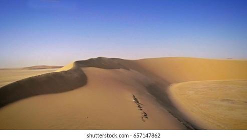 Aerial View of golden Desert & blue sky