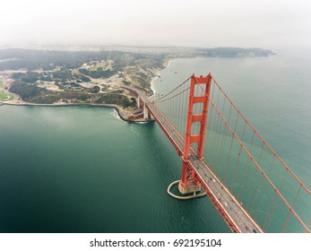 Aerial view of Golden Gate Bridge in warm tone, famous landmark in San Francisco