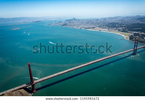 An aerial view of Golden Gate Bridge and San Francisco Bay