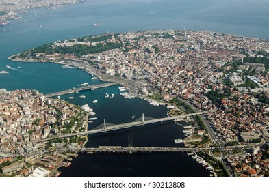 Aerial view of the Golden Horn and Old City of Istanbul with the famous Topkapi Palace, Hagia Sophia and Blue Mosque visible in the distance and the bridges crossing the city's natural harbour.