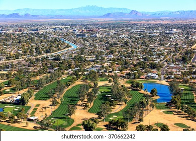 Aerial view of golf course with Scottsdale, Arizona skyline