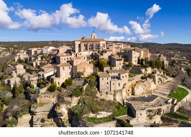 Aerial view of Gordes, labelled Most Beautiful Villages of France, perched on a rocky outcrop at the end of the Vaucluse plateau,
