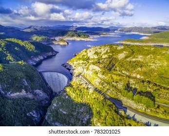 Aerial view of Gordon Dam and lake at sunset in Tasmania, Australia