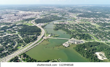 An aerial view of a gorgeous town by the lake on a summer day.