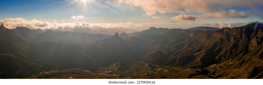 Aerial view of the Gran Canaria mountains in the middle of the island with Teide volcano view over the clouds.
