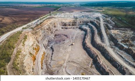 Aerial view of the granite quarry. Development of granite rock in Ukraine