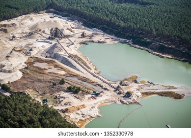 Aerial view of gravel mining and factory plant producing sand materials for the construction industry. aerial view of industrial place in Germany