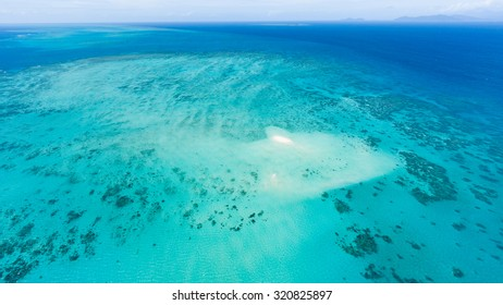 Aerial view of Great Barrier Reef with coral sand cay beach, Queensland, Australia