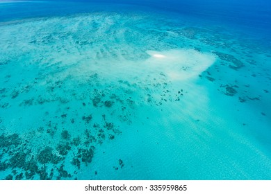 Aerial view of Great Barrier Reef and coral sand cay from helicopter flight, Queensland, Australia