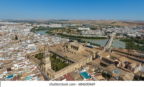 Aerial view of the Great Mosque - Cathedral (Mezquita Cathedral) and Roman bridge in Córdoba in, Spain