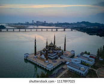 Aerial view of Great Mosque during sunrise at Kuala Terengganu, Malaysia taken by drone.