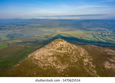 Aerial view of the Great Sugarloaf basking in a summers sunrise.