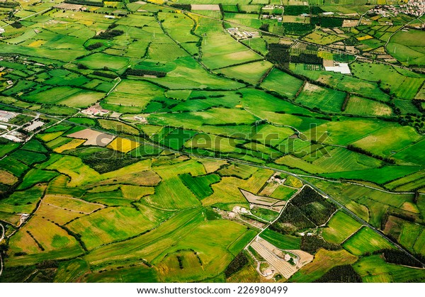 Aerial view of green farmland of the countryside