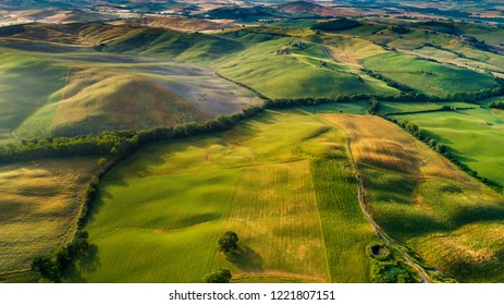 Aerial view of green farms and mountains and beautiful landscapes