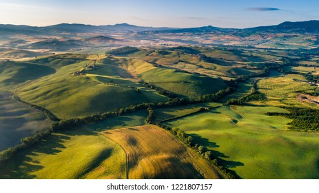 Aerial view of green farms, mountains and beautiful landscapes in Tuscany