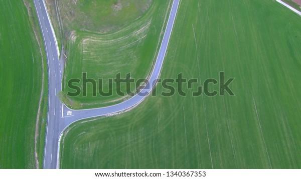Aerial view in green field of village near of Montserrat. Barcelona. Spain. Drone Photo