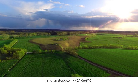 Aerial view of green fields in the sunset - germany