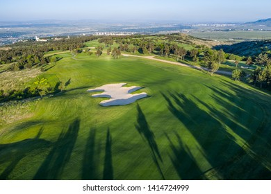 Aerial view of the green golf course in Tbilisi. Georgia. Bird's-eye.