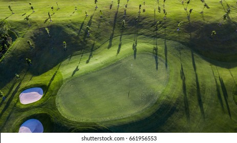 Aerial view of green golf course.
