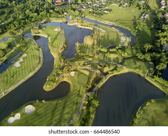Aerial view of the green golf course in Thailand.