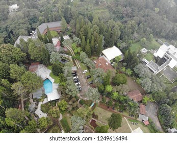 Aerial view of green hill and a swimming pool in Cipanas, West Java Indonesia