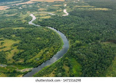 Aerial View Green Meadow, Forest And River Landscape In Spring Evening. Top View Of Beautiful European Nature From High Attitude In Summer Season. Drone View. Bird's Eye View.