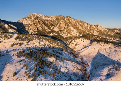 Aerial view of Green Mountain at sunrise during winter in Boulder, Colorado.