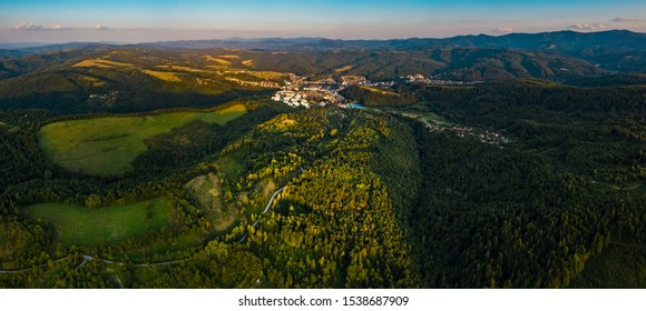 Aerial view of green valley during colorful sunset