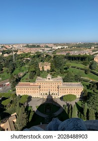 Aerial view of green Vatican city gardens. Government office building and Santa Maria Regina della Famiglia chapel in front. Vatican city, Vatican.