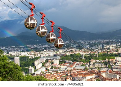 Aerial view of Grenoble, French Alps and cable car from the Bastille hill, France