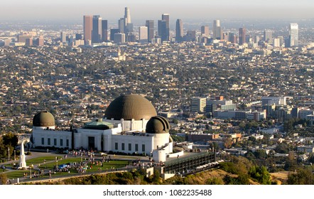 Aerial view of Griffith Observatory and downtown Los Angeles in the background on a clear, sunny day