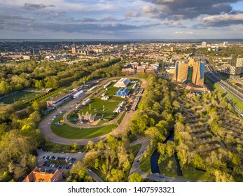Aerial View of Groningen city Skyline from main park Stadspark area with festival builing up on racetrack event grounds, Netherlands