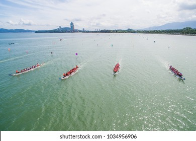 aerial view of a group of dragon boat paddler practice at Likas Bay Sabah Malaysia. Dragon boat competition is an annual event in Sabah Malaysia.