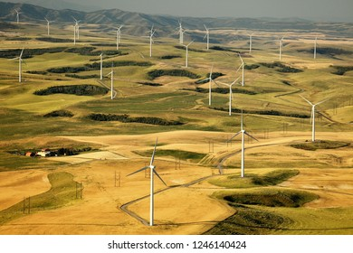 An aerial view of a group of ecologically friendly wind generators