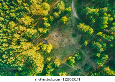 Aerial view of group of people performing human hear shape in fileds near Nida, Lithuania